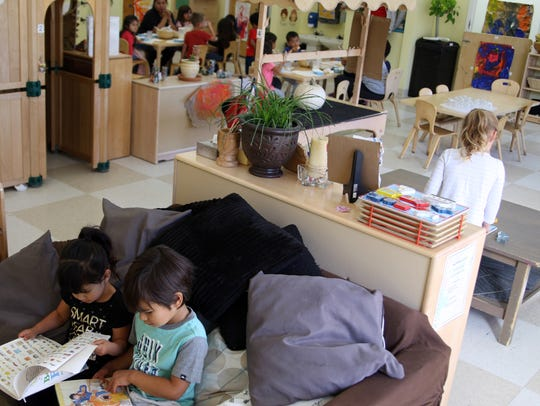Students reading, playing and snacking at Crescita
