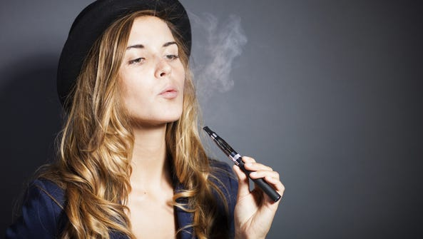 Young woman smoking e-cigarette