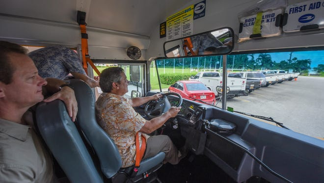 Gov. Eddie Calvo takes a quick drive around Adelup Park while behind the wheel of a Department of Public Works school bus, equipped with an onboard security camera, on Wednesday, Aug. 16, 2017. Public school students are scheduled to return to class on Thursday, Aug 17, and the cameras have been installed in over 30 school buses to monitor the riders.