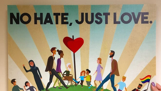 """No hate, just love"" yard signs were handed out at the inaugural Central Indiana Response to Hate Conference, hosted by the Fair Housing Center of Central Indiana on Thursday, August 17, 2017."