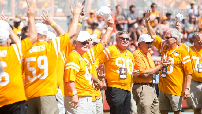 The 1967 National Championship team is honored during Tennessee's game against UMass in Neyland Stadium on Saturday, Sept. 23, 2017.