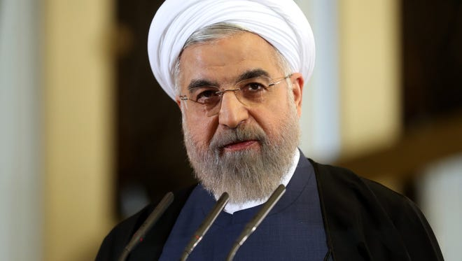Iranian President Hassan Rouhani speaks in a news briefing at the Saadabad palace in Tehran.