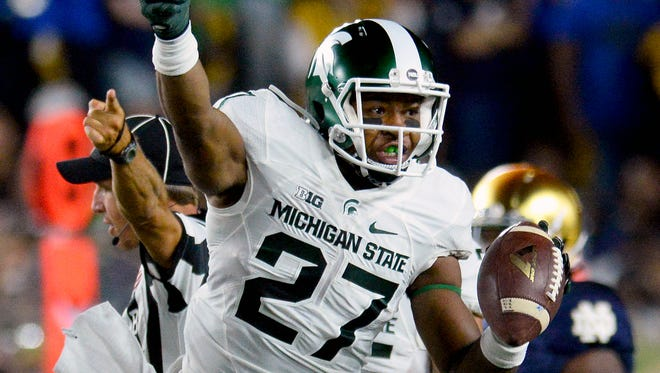 Michigan State University sophomore safety Khari Willis (27) celebrates after recovering a fumble in the first half of the Spartans game against Notre Dame Saturday, Sept. 17, 2016 in South Bend, Ind.