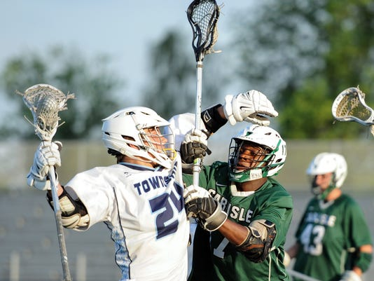 Carlisle's Tim Roesler delivers a check on Manheim Township's Grayson Sallade in the opening round of the District 3 playoffs. The Blue Streaks defeated the Thundering Herd 14-7 at Manheim Township High School on Tuesday, May 12, 2015. Patrick Blain for GameTimePA.com