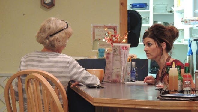 Michelle Zuidema takes a lunch order for longtime customer Betty Sandvig.
