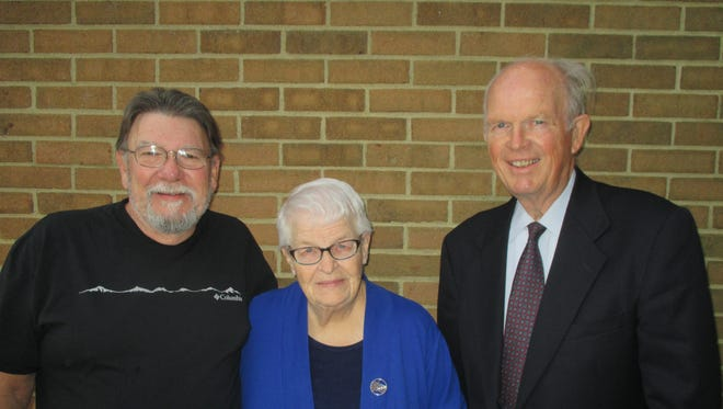 Doug Thornton, Winnie Allen (standing in for her son, Col. Charles Allen), and Marvin Fisher II were honored on November 13 as Graduates of Distinction at Spencer Van Etten High School.