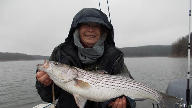 81-year-old Sally with her first striper.
