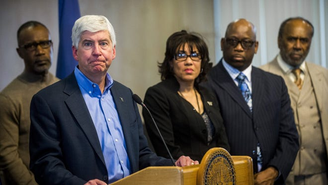 Rick Snyder speaks during a news conference in Flint, Mich. the fallout from a water crisis in another impoverished city have marred the Republican's image as a practical problem-solver.
