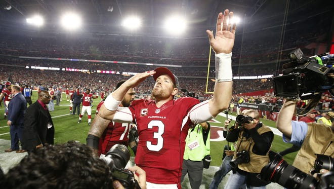 Arizona Cardinals quarterback Carson Palmer blows a kiss to his family after defeating the Green Bay Packers in overtime during an NFC divisional playoff game on Jan. 16, 2016 in Glendale, Ariz.