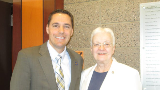 Roger Roth (left) and Sister Pamela Moehring were recognized by St. Mary Catholic Schools with alumni awards for their contributions to society.