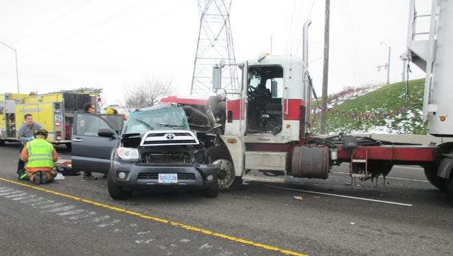 Emergency personnel respond to a fatal crash on southbound Interstate 5 in Woodburn.