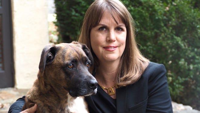 "Elizabeth Kostova with her dog, Jacob. A Bulgarian dog named Stoycho accompanies Alexandra and Bobby in ""The Shadow Land."""