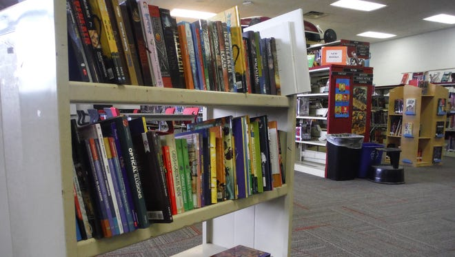 Owen Middle School has several new books, thanks to a grant by local Kiwanis Club members.