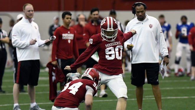 Indiana Hoosiers kicker Jared Smolar (90) attempts a kick during IU's Cream and Crimson spring game at Mellencamp Pavilion in Bloomington, Ind., on Saturday, April 14, 2018.