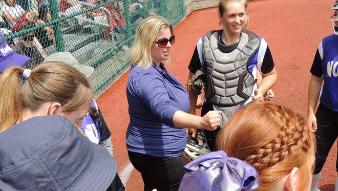 North Kitsap softball coach Jamie Smalaaden (center) and the Vikings are headed to the Class 2A state tournament for the first time since 2006.