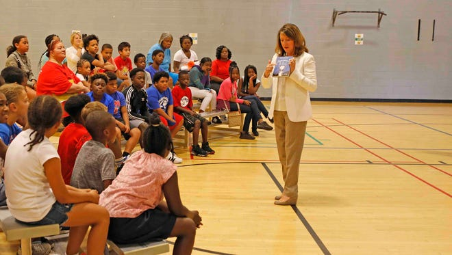 Tennessee First Lady Crissy Haslam describes one of the books given away at the kick-off event for Read20 Book Patrol at the Kleeman Community Center July 9, 2018.