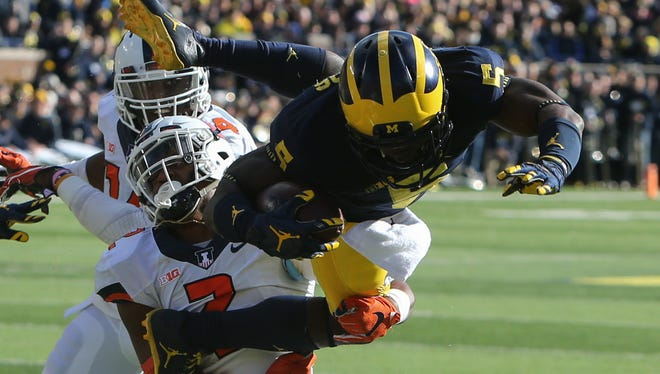 Michigan's Jabrill Peppers is tackled by Illinois' Julian Jones during the first quarter of U-M's 41-8 win Saturday.