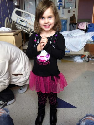 Helena White poses for a picture just before leaving Blair E. Batson Children's Hospital for fifteen days.