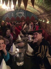 London dungeon: Stayton High School choir in costume during a meal at London Dungeon.