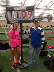 Colonel Crawford vaulter Callie Ruffener stands next to the sign displaying her winning height in the Division II-III competition at the state indoor meet.