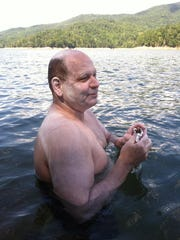 Jim Cottam, Roberson High swim coach, will attempt a 26.2-mile swim across Fontana Lake to raise money for a breast cancer charity.