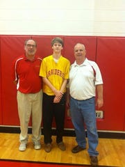 Coach Dan Catignani (left) poses with longtime friend and coach Chuck Curran (right) and former Christ the King student Jack McLaughlin in 2014.