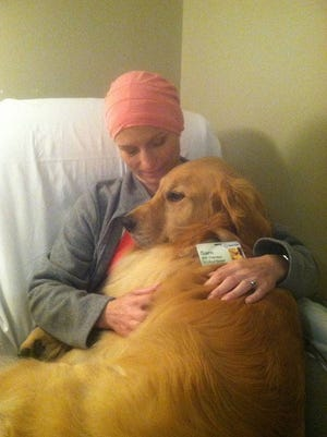 Sparrow Hospital Volunteer Coordinator Tracy Feazel with Sam during her cancer treatments.