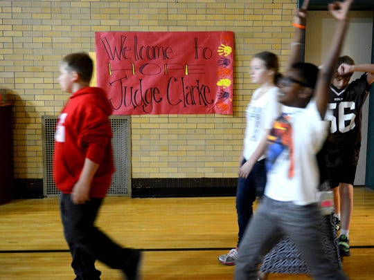Students walk by a sign welcoming Ingham County Judge Hugh Clarke, Jr., Sept. 25, 2015, as they prepare for an assembly at Hope Middle School in Holt. Clarke was speaking to them about the HistoryMakers project. HistoryMakers is a nationwide effort to explain the importance of education and tell the story of well-known and unsung African Americans.