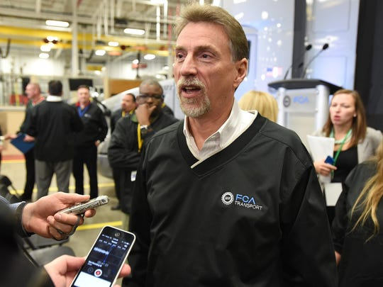 Norwood Jewell, vice president of the UAW, answers questions about Fiat Chrysler Automobiles, FCA, converting its diesel-powered Detroit transport truck fleet into natural gas powered during a press conference Friday, December 4, 2015 at the FCA transport facility in Detroit.