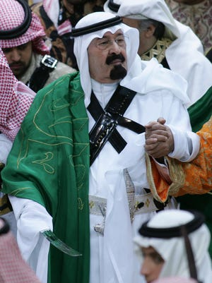 In February 2007, King Abdullah, centerholds his sword as he takes part in the traditional Arda dance, or war dance, during the Janadriyah Festival of Heritage and Culture on the outskirts of Riyadh.