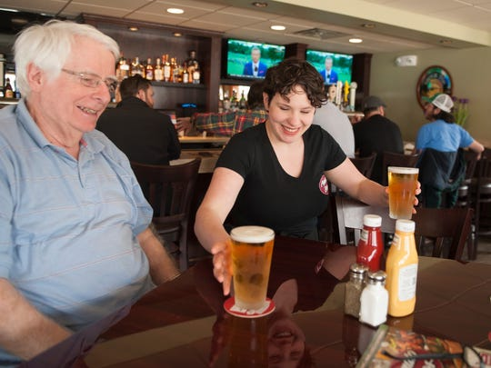 Waitress Haleigh Bunting serves a beer to John McCloskey of Haddon Township at Amato Bros. in Oaklyn.