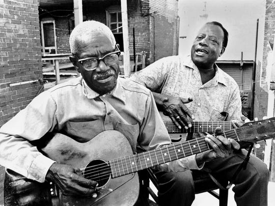 "Furry Lewis and Bukka (Booker T. Washington) White dated May 1967. Born in Greenwood, Miss., Lewis moved with his family to Memphis in 1900. At 13 he had run away to join a medicine show with the legendary Memphis songster Jim Jackson. On returning to Memphis at the ripe age of 15, he played briefly with one of Handy's bands. Lewis frequently told interviewers that Handy was the man who gave him his first good guitar. Lewis, considered by many to be the quintessential Beale Street bluesman, was ""rediscovered"" by the national blues-folk revival in the 1960's. Hwas featured as an opening act at the Rolling Stones 1975 appearance at the Liberty Bowl. Bukka White first recorded in 1930 for Victor. The Memphis session yielded two train songs - The New Frisco Train and The Panama Unlimited - and two gospel numbers released as ""The Singing Preacher."" The 78s didn't sell that well, and White found himself itinerant, playing semi-pro baseball for the Birmingham Black Cats and boxing in Chicago. White became one of the most popular bluesmen of the '60s folk revival, touring Europe as part of the American Folk Blues Festival and playing at the 1968 Olympics in Mexico City. He died Feb. 26, 1977."