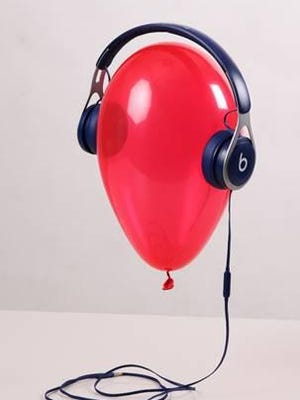 "Danielle Banfield's winning entry in the Congressional Art Competition, titled ""Music Lifts Us,"" shows a floating red balloon wearing headphones."