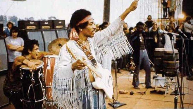 Jimi Hendrix performs at Woodstock Musical Festival.