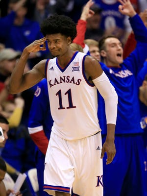 Kansas' Josh Jackson salutes his teammates after a three-point basket against Baylor on Feb. 1, 2017. He scored 23 points in the 73-68 win.