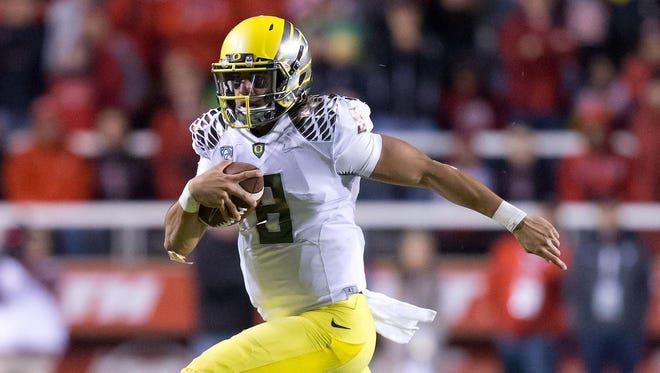 Oregon's Marcus Mariota had a season-high in rushing yardage on Saturday at Utah.