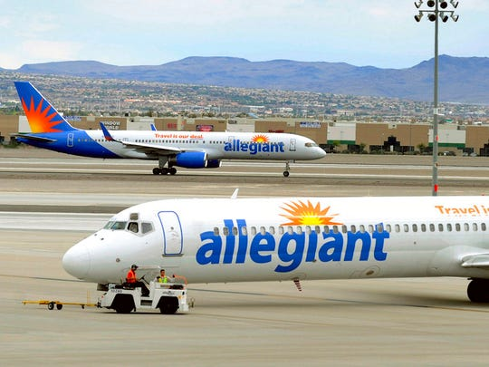 In this May 9, 2013, file photo, two Allegiant Air jets taxi at McCarran International Airport in Las Vegas.