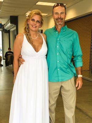 Misty, left, and John Marsh were married Thursday at Kentucky Speedway.