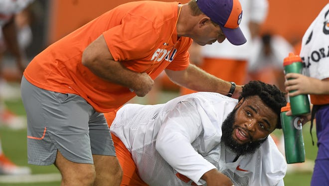 Clemson head coach Dabo Swinney and defensive lineman Christian Wilkins (42) during the Tigers opening day of practice on Friday, August 3, 2018.