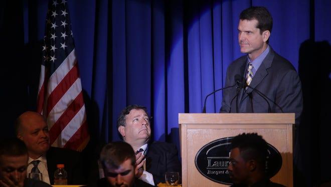 Michigan football coach Jim Harbaugh talks during the Michigan football banquet on Monday, Dec. 7, 2015, at Laurel Manor in Livonia.