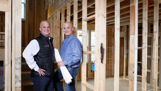 Twin brothers John and Jim McKenzie combine their skills to make their homebuilding business, Homes by McKenzie, a success.