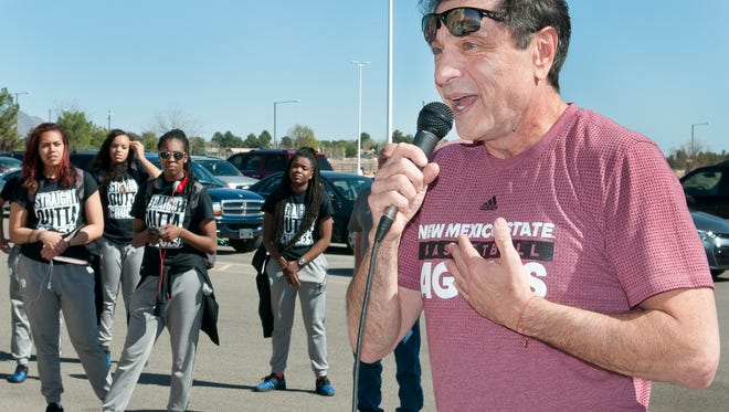 New Mexico State women's basketball coach Mark Trakh addresses the crowd gathered at the Pan American Center parking lot to wish the Aggies good luck as they departed for Tempe, Ariz.