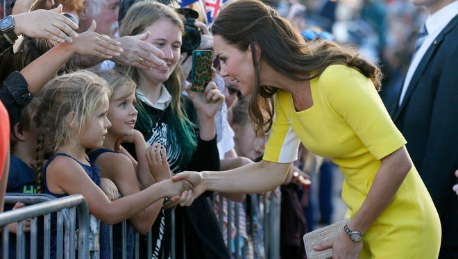 Britain's Kate, the Duchess of Cambridge, as she meets with people on the steps of the Sydney Opera House following a reception in Sydney, Australia on April 16, 2014.