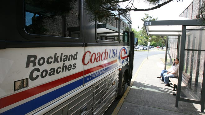 A Rockland Coaches bus picks up passengers at the Nanuet Mall May 12, 2009. They are planning to scale back service to and from Rockland, and raise bus fares, on June 1.  ( Peter Carr / The Journal News )