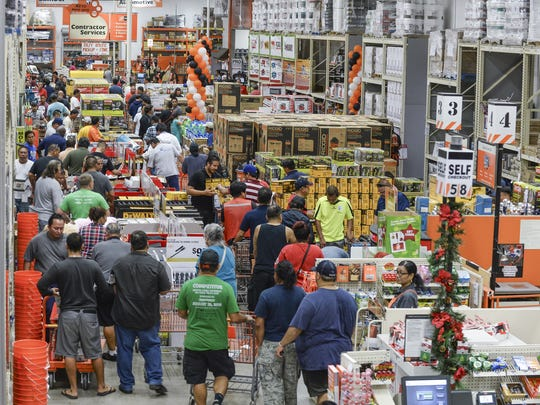 Shoppers hustle about in the aisles during the Black Friday sale at The Home Depot on Nov. 27, 2015.