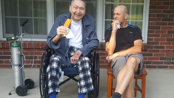Tony and Jerry Jacob enjoy some Popsicles.