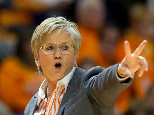 FILE - In this Dec. 10, 2017 file photo, Tennessee head coach Holly Warlick calls to her team in an NCAA college basketball game against Texas in Knoxville, Tenn. The seventh-ranked Lady Vols (10-0) are back in the top 10 for the first time in two seasons after an 82-75 home victory Sunday over No. 8 Texas, which was ranked second at the time. Tennessee will put that ranking to the test the rest of this month during a 3 ½-week stretch without a home game. (AP Photo/Calvin Mattheis, File)