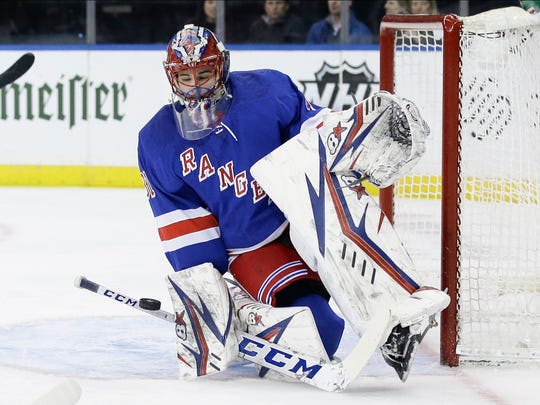 New York Rangers goaltender Igor Shesterkin (31) deflects a shot on goal during the first period of an NHL hockey game against the Toronto Maple Leafs Wednesday, Feb. 5, 2020, in New York. (AP Photo/Frank Franklin II)