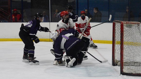 North Rockland forward Colin Callanan gets nudged into