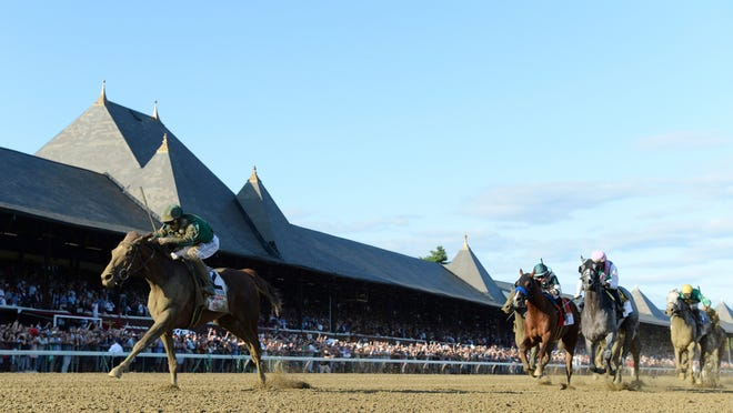 In a photo provided by the NYRA, Code of Honor, left, with jockey John Velazquez, wins the Travers Stakes horse race Saturday, Aug. 24, 2019, at Saratoga Race Course in Saratoga Springs, N.Y. (Coglianese Photos/NYRA via AP)